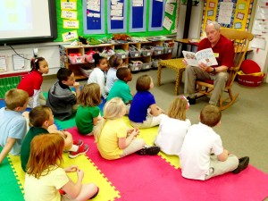 Rotarian Dr. Bill Wooten reads to the first grade.